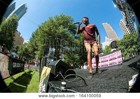 ATLANTA, GA - OCTOBER 2016:  Circular fisheye perspective of unidentified male artist performing on the stage at Atlanta Hip Hop Day a free festival open to the public at Woodruff Park in downtown Atlanta in Atlanta GA on October 8 2016.