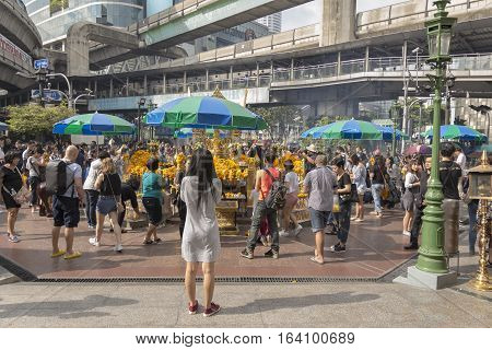 BANGKOK THAILAND - DEC 31 : view of Unidentified crowd inside Erawan shrine while new year festival on december 31 2016 Thailand. Erawan shrine is famously place in ratchaprasong area