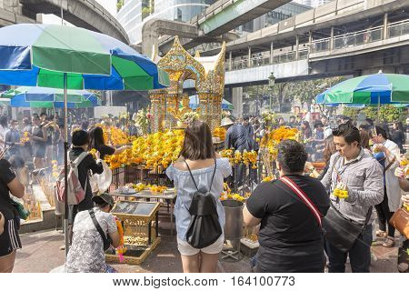 BANGKOKTHAILAND - DEC 31 : scene of people worship in Erawan shrine in ratchaprasong area while new year festival on december 31 2016 Thailand. Erawan shrine is famous place for tourist