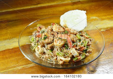 spicy glass noodle with shrimp salad on dish