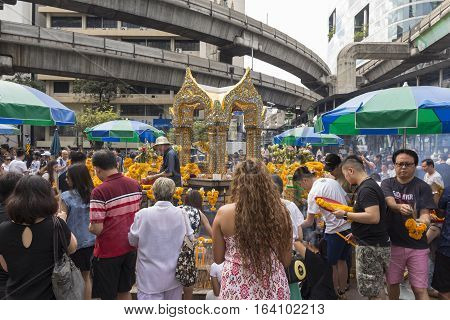 BANGKOKTHAILAND - DEC 31 : tourist worship at Erawan shrine in ratchaprasong area on december 31 2016 Thailand. there are many tourist worship at Erawan shrine in new year festival