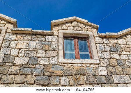 Window of the typical house in Tucepi old village in the slope of a mountain Biokovo.
