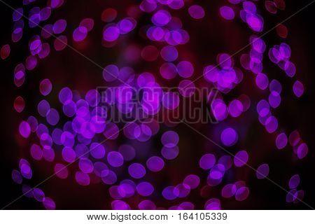 Bokeh background glowing oval shaped glow dark deep purple empty