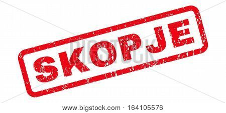 Skopje text rubber seal stamp watermark. Tag inside rounded rectangular banner with grunge design and unclean texture. Slanted glyph red ink emblem on a white background.