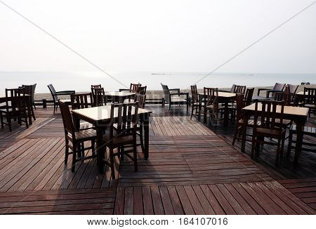 Beach front outdoor table with ocean background silhouette