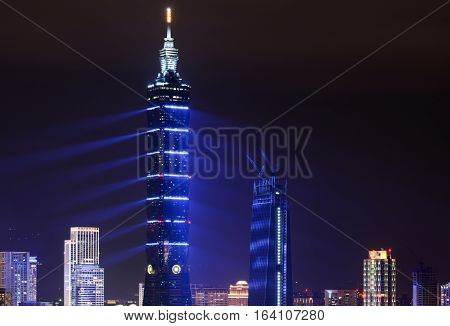 TAIPEI, TAIWAN - JANUARY 1, 2017 - Blue lasers give Taipei 101 a futuristic appearance during a 2017 New Year fireworks and light show in Taiwan