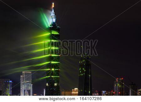 TAIPEI, TAIWAN - JANUARY 1, 2017 - Green lasers give Taipei 101 a Matrix-like atmosphere for the 2017 New Year fireworks and light display in Taiwan