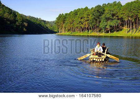 December 16 2016-Pang Oung Mae Hong Son Thailand: Bamboo raft floating in clear water in the morning at Pang Oung Lake (Pang Tong reservoir)