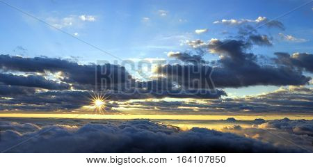 Panorama view of beautiful sunrise over the misty valley and dark cloudy sky. Doi Inthanon National Park Chiang Mai Thailand