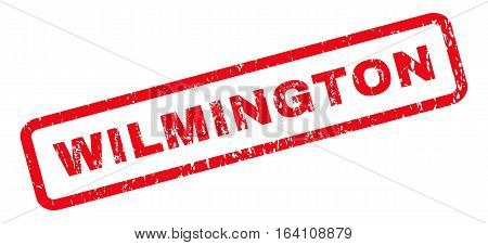 Wilmington text rubber seal stamp watermark. Caption inside rounded rectangular banner with grunge design and dirty texture. Slanted glyph red ink emblem on a white background.