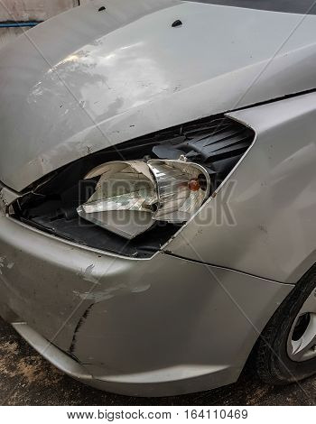Car an accident with side headlight damage