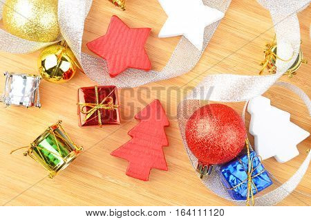 Christmas tree and decor on natural wooden background