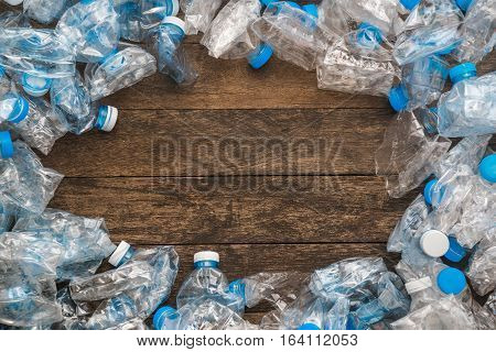 Recycling concept. The problem of ecology environmental pollution. Background of plastic bottles transparent blue net. In the center of an empty space for writing.