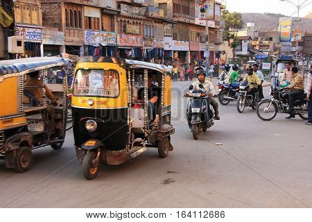 Jodhpur, India - February 11: Unidentified People Ride Motobikes At Sadar Market At Sunset On Februa