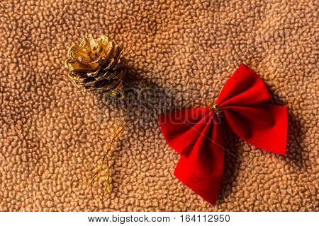Pine cones with bow on fabric christmas still life