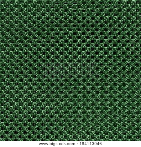 Green fishnet cloth material texture background. Nylon texture. Nylon fabric. Nylon bag for background with copy space for text or image.