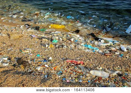 Detail of a beach polluted with plastic garbage