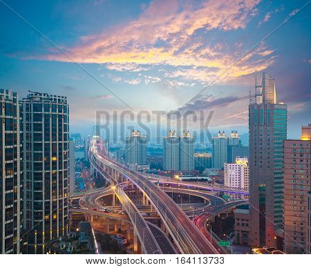 Aerial photography at city elevated bridge of sunset pink clouds