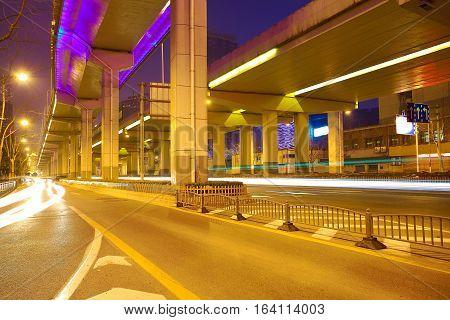 Empty road surface floor with city overpass viaduct bridge of night scene in shanghai