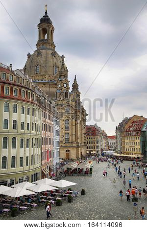 DRESDEN GERMANY - AUGUST 13 2016: People walk on Neumarkt Square at Frauenkirche (Our Lady church) in the center of Old town in Dresden State of Saxony Germany on August 13 2016.