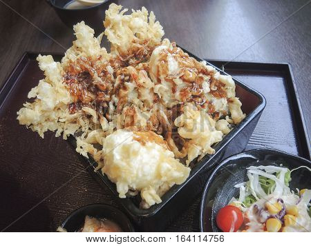 Prawn egg and vegetable tempura Donburi is crisp tempura laid over freshly steamed rice and topped with soy sauce based dressing.