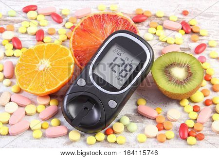 Glucometer With Result, Fruits And Colorful Medical Pills, Diabetes, Healthy Lifestyle And Nutrition