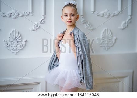 Young Ballet Dancer Standing Near The Wall