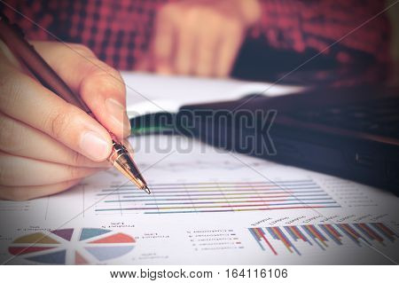 Close Up Young Man Hand Writing With Calculating And Using Laptop Searching Analysing Data At Home O