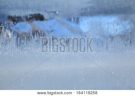 Frozen patterns on a frozen block of ice