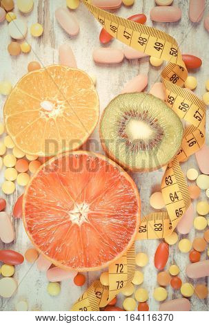 Vintage Photo, Natural Fruits, Centimeter And Medical Pills, Slimming, Choice Between Healthy Nutrit