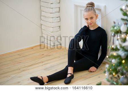 Young Ballet Dancer Sitting Near The Wall
