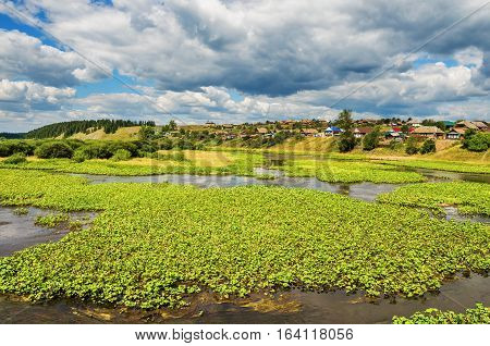 Summer landscape. The village Staroutkinsk located on the banks of the river Chusovaya. Russia. Ural