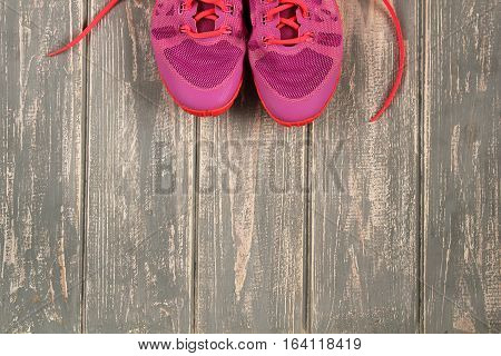 Trainers on wood floor. Stock photo Sporty mock up
