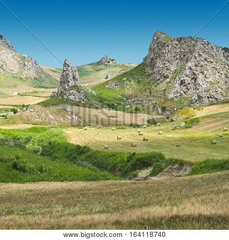 Rocky Landscape of Sicily with Many Hay Bales