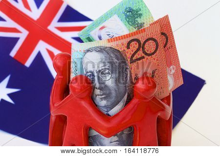 Australian dollar notes huddled together with the Australian flag.