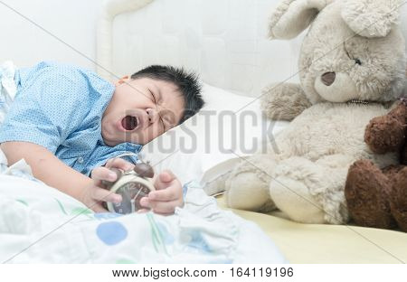 Cute Boy Wakes Up And Yawning.