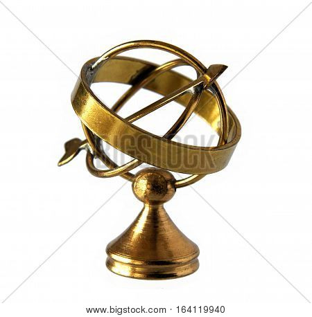 Miniature of ancient brass astrolabe isolated on white background