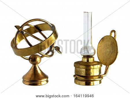 Miniature of ancient brass astrolabe and kerosene lamp isolated on white background