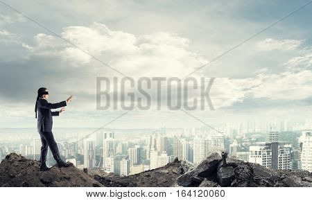 Concept of risk and danger in business with man steping blind
