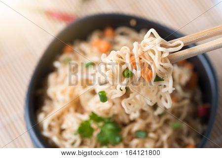 Instant Noodles With Vegetables On Chopstick
