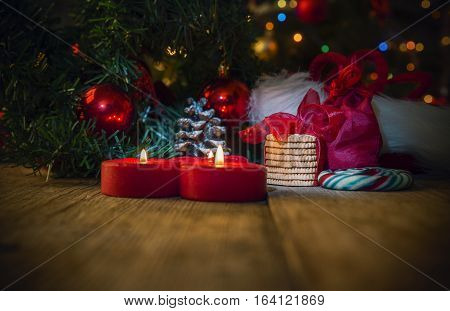 Christmas decoration on the wooden table with candeles