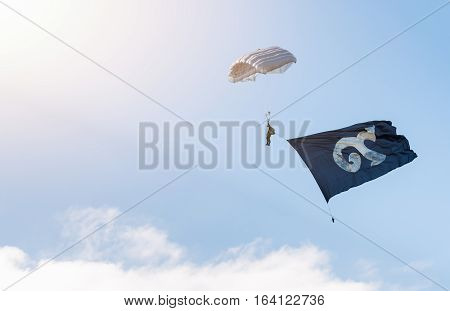 Military parachutist with traditional Thai alphabet number nine on flag