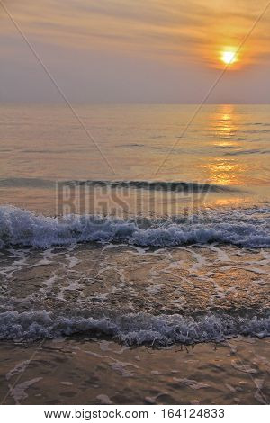 Beautiful tropical sunset beach silhouette over the sea