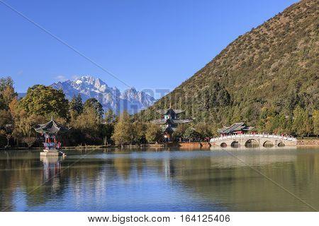Beautiful view of the Black Dragon Pool and Jade Dragon Snow Mountain in Lijiang Yunnan - China
