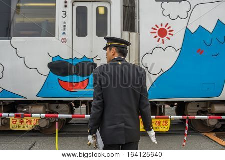 Kawaguchiko, JAPAN - 20 NOV 2016: Train station security officer at Kawaguchiko railway station. The railway system is one of the most important public transportation in Japan.