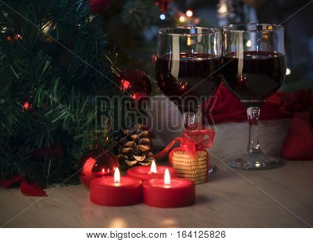 Christmas decoration whit vine on the wooden table