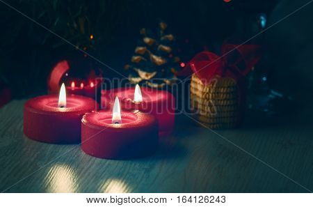 Christmas decoration with candeles on the wooden table