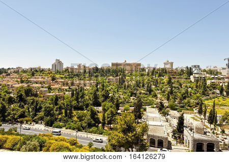 View from top of ancient walls surrounding Old City in Jerusalem. View on the landmarks of Jerusalem Old City.