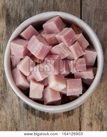 bacon close up cut in bowl on wooden table