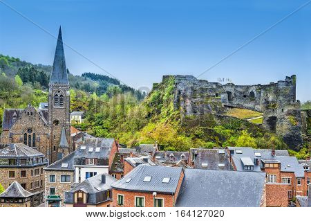 View of the Church and the Castle in the Belgian City of La Roche. View of the town centre below its medieval Castle in of La Roche.